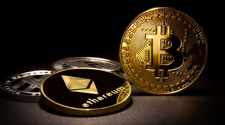 Bitcoin, Ethereum, Litecoin, and Ripple coins with soft portrait lighting