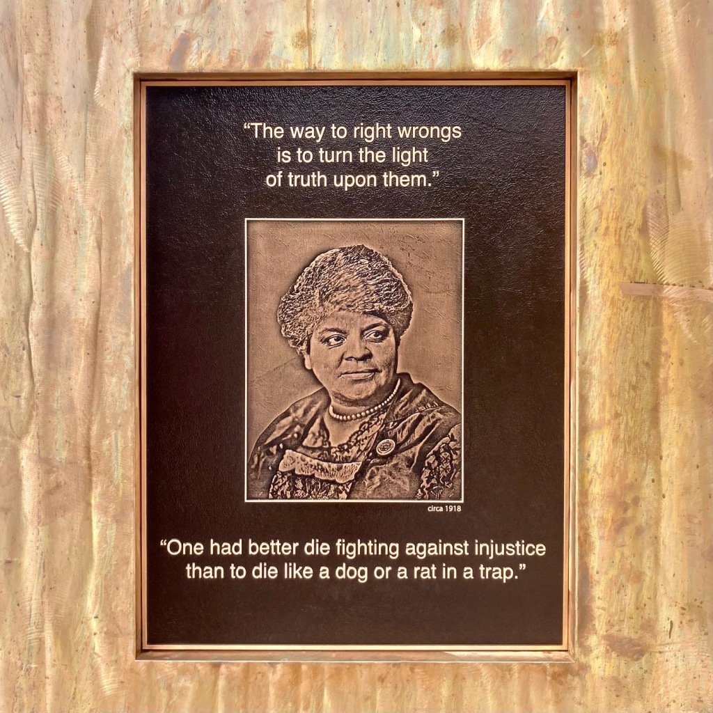 """A plaque on the Ida B. Wells monument states, """"The way to right wrongs is to turn the light of truth upon them."""" Photo © Logan Aimone."""